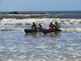 Riding the waves . . . Canoe crew (from left) Swannee Taiawa, Dave McPhee, Geoff Lennon and Alex Sutherland train at the beach on Saturday. Taiawa, McPhee and Lennon are part of the club's maters canoe team. PHOTO: JESSICA WILSON